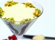 a bicolor pudding decorated with cranberries and two kinds of chocolate